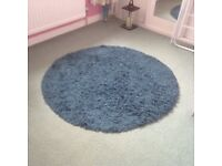 Teal circular rug