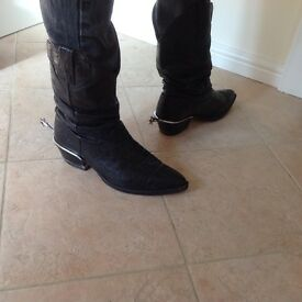Vintage black cowboy boots with spurs