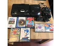 Sega megadrive and mega cd console with games