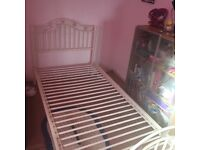 Metal frame single bedstead with hearts