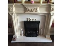 Decorative fire surround with marble back and hearth. Good condition