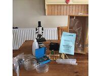 Microscope and examination equipment