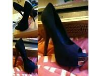 Brand new never worn black heels
