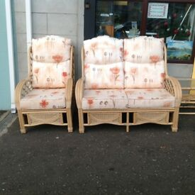This is a beautiful Cane 2 seater sofa, 2 armchairs and a table