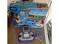v tech V Smile TV learning system complete with game also hand held vision with game £10