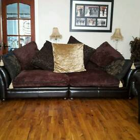Three piece leather and fabric sofa