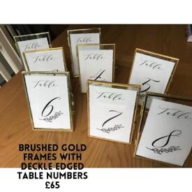 Gold photo frames with table numbers