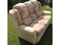 Three-seater sofa and matching footstool