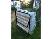 Put me up folding bed with sprung single mattress