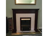Mahogany fireplace with electric fire and mirror