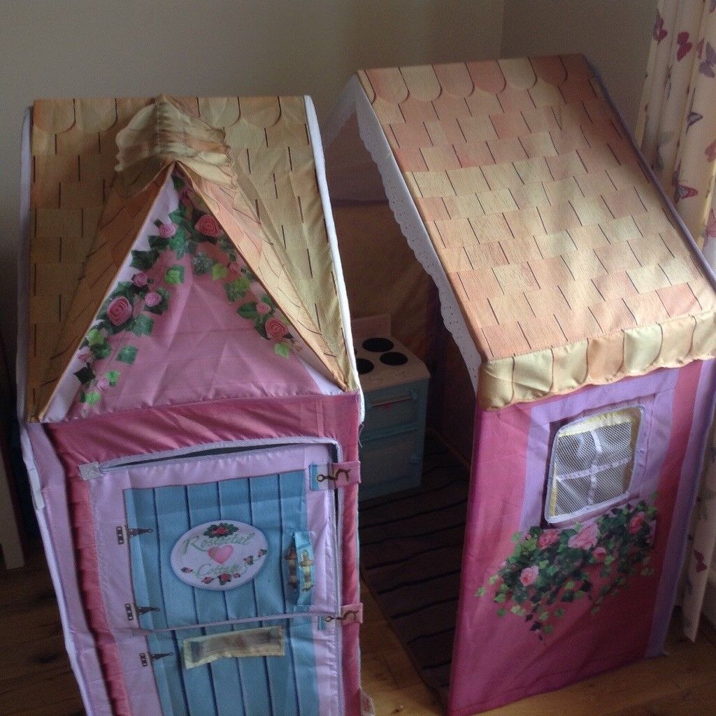 Girl's playhouse with cooker and curtains