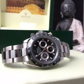 New boxed & bagged silver strap black face & besel rolex daytona