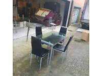 glass top dining room table and 6 chairs