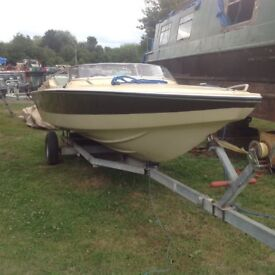 Speedboat mercury outboard and trailer