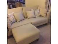 Cream fabric sofa and storage footstool from oak furniture land