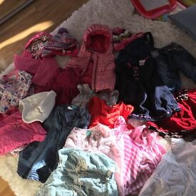 A large bag of baby girl clothes 6-18 months