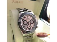 Silver Rolex Daytona Silver Face and black Ceramic Bezel Comes Rolex Bagged and Boxed Paperwork