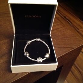 Genuine Pandora Bracelet with 21 st charm for sale