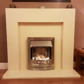 Silver electric fireplace with cream surround mantlepiece