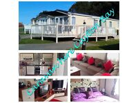 Stunning 2 bedroom caravan with large veranda and parking space for hire on Cayton Bay Holiday Park