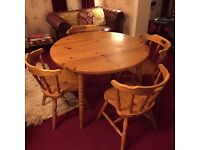 Farmhouse rustic vintage 1970s natural pine dining table and four bucket chairs