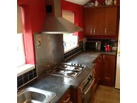 Kitchen cupboards, oven extractor, hob and integrated dishwasher, sink and taps.