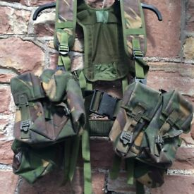 Army combat webbing yoke including pouches.