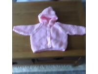 Hand knitted hooded baby kacket