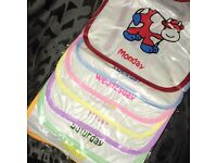 Baby bibs, wipe clean 7 days of the week bibs. suitable from 0+ months. Tie detail & cute design
