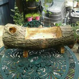 Wood log planter