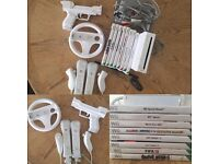 Wii console, 2x Controllers inc. Nunchucks 7 games & accessories