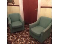 Two green tub chairs for sale