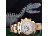 Gold Rolex Daytona with white face, gold bezel with all gold oyster bracelet. Comes in Rolex box