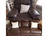 Brown leather reclining couch and chair.
