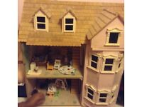 Dolls house for 3-8 years with all accessories. It's about 1 meter high and wide