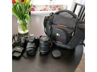 Canon 1000d with zoom lens and durable carry case