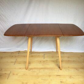 Vintage Ercol extending drop leaf plank dining kitchen table