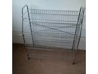 elegant stainless steel shoe rack in pristine condition