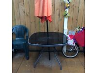 Table,umbrella and four chairs