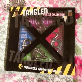 Tangled Metal Puzzle Collection. Four Infuriating Puzzles. New Condition.