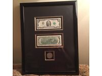 Two mint condition $2 notes and a dollar coin, beautifully presented, mounted and framed
