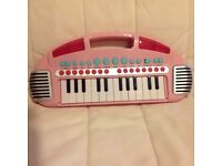Child's piano with new batteries, also has its own tunes!