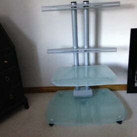 TV Trolly Stand. 2 frosted glass shelves. All fixings included. Very good condition.