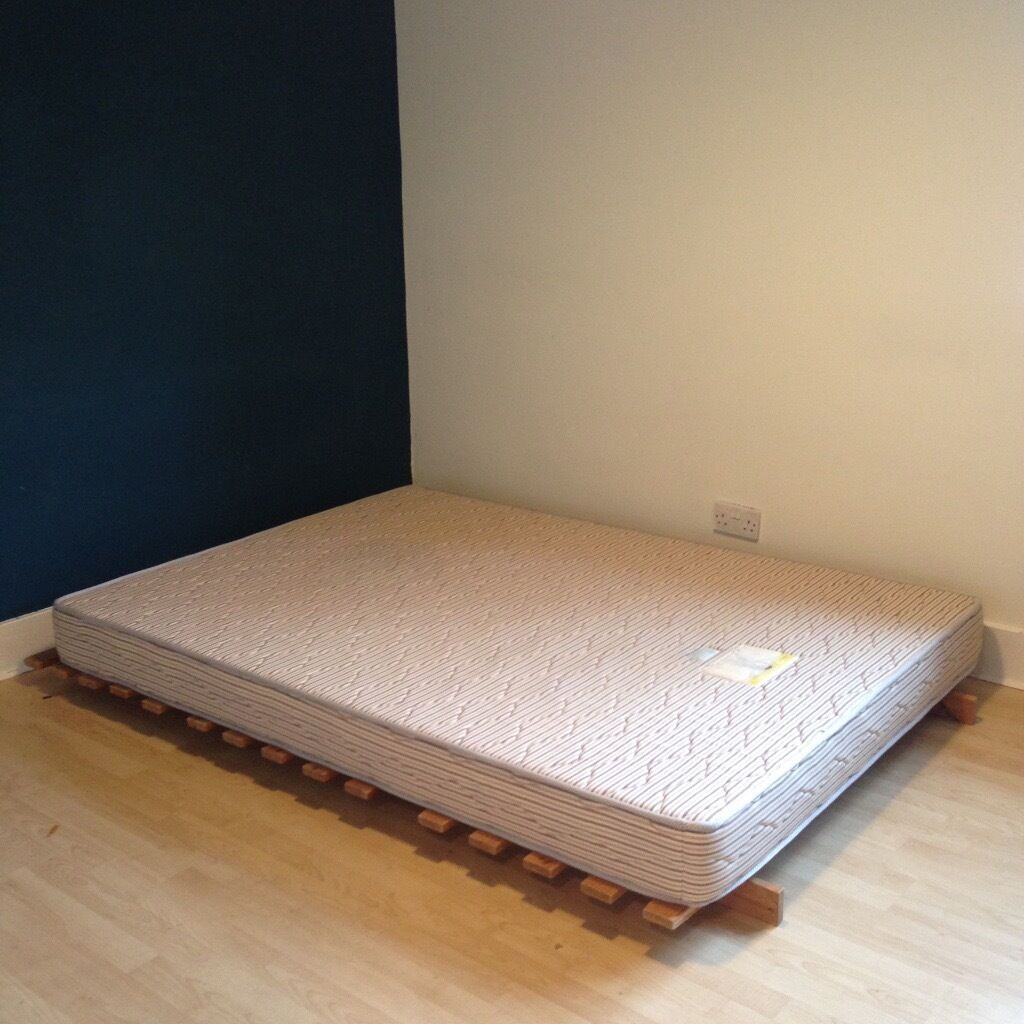 Firm double mattress and wooden frame