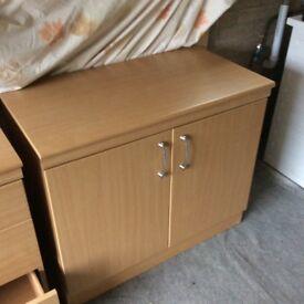 Cupboard, beech laminate, single shelf. Double doors. Good condition.