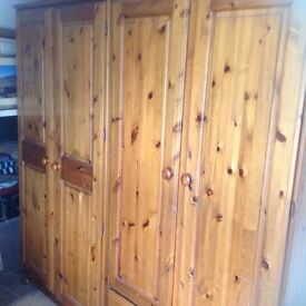 Wardrobes Two double pine 'Ducal' wardrobes, one eight drawer pine dresser, one pine blanket box,