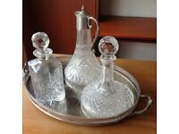 Three cut-glass drinks decanters and tray