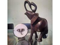 Wooden carved elephant and candle holder with candle