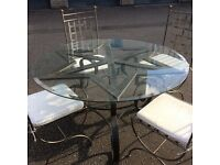 Dining table and 4 chairs. Solid metal. Glass top