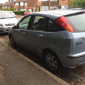 Ford Focus, good runner. MOT till March. Small dents but still in very good condition.